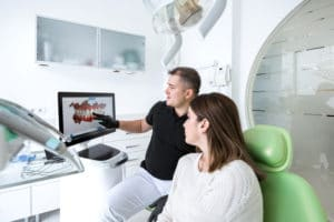 Dentist talks to her patient about three-dimensional smile design